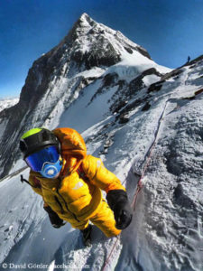 David Göttler below Everest South Col (wearing a mask for moister breath).