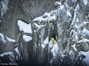 Schaeli climbs a key section of the Petit Dru North Face